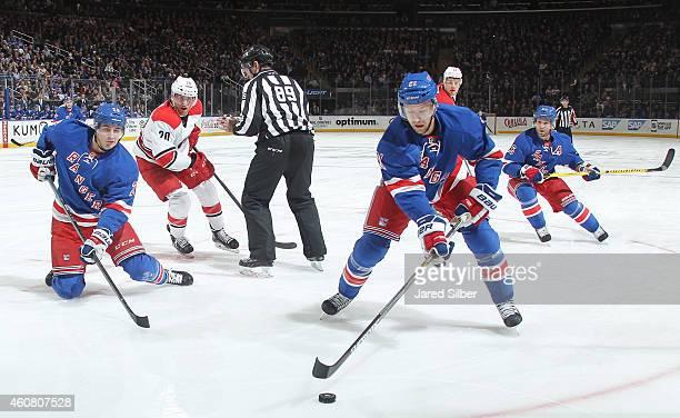 Derek Stepan Chris Kreider and Martin St Louis of the New York Rangers skate against Riley Nash and Alexander Semin of the Carolina Hurricanes at...