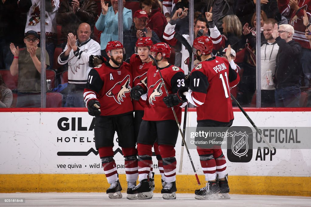 Derek Stepan #21, Christian Dvorak #18, Alex Goligoski #33 and Brendan Perlini #11 of the Arizona Coyotes celebrate after Goligoski scored against the Vancouver Canucks during the third period of the NHL game at Gila River Arena on February 25, 2018 in Glendale, Arizona. The Canucks defeated the Coyotes 3-1.