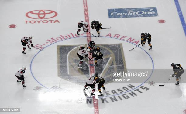 Derek Stepan of the Arizona Coyotes and Cody Eakin of the Vegas Golden Knights take the opening face off at the start of the the Golden Knights'...