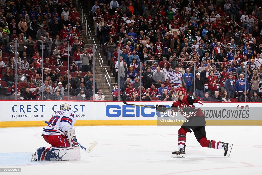 Derek Stepan #21 of the Arizona Coyotes attempts a overtime shootout against goaltender Henrik Lundqvist #30 of the New York Rangers in the NHL game at Gila River Arena on January 6, 2018 in Glendale, Arizona. The Rangers defeated the Coyotes 2-1 in an overtime shootout.