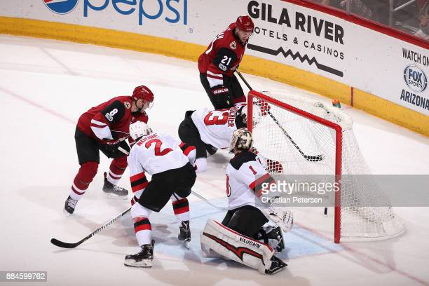 Derek Stepan of the Arizona Coyotes scores a goal past goaltender Keith Kinkaid of the New Jersey Devils during the first period of the NHL game at...