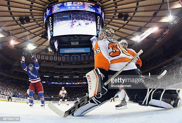 Derek Stepan of the New York Rangers celebrates a goal by Marc Staal against Steve Mason of the Philadelphia Flyers during the first period in Game...