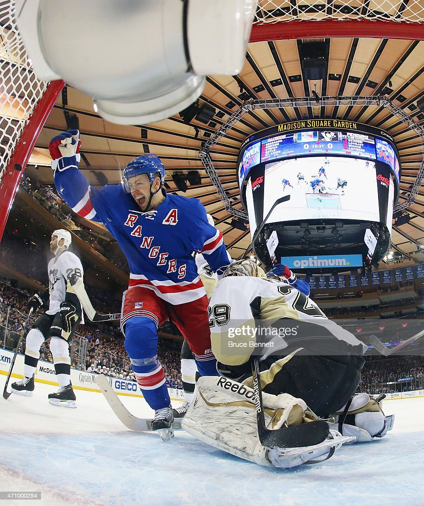 Derek Stepan #21 of the New York Rangers celebrates his powerplay goal at 4:23 of the first period against Marc-Andre Fleury #29 of the Pittsburgh Penguins in Game Five of the Eastern Conference Quarterfinals during the 2015 NHL Stanley Cup Playoffs at Madison Square Garden on April 24, 2015 in New York City.