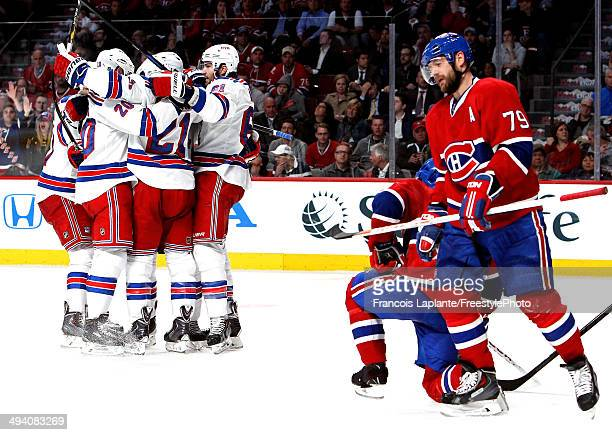 Derek Stepan of the New York Rangers celebrates his second period goal at 12:06 against the Montreal Canadiens during Game Five of the Eastern...
