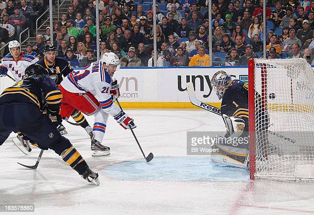 Derek Stepan of the New York Rangers scores a second period goal against Jhonas Enroth of the Buffalo Sabres on March 12 2013 at the First Niagara...