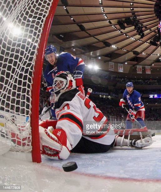 Derek Stepan of the New York Rangers watches a shot by Marc Staal enter the net against Martin Brodeur of the New Jersey Devils during the second...
