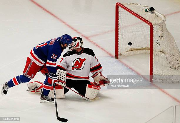 Derek Stepan watches as a third period goal by teammate Dan Girardi of the New York Rangers gets past Martin Brodeur of the New Jersey Devils in Game...