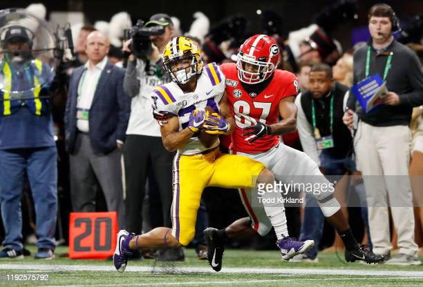 Derek Stingley Jr. #24 of the LSU Tigers intercepts a pass in the first half against the Georgia Bulldogs during the SEC Championship game at...