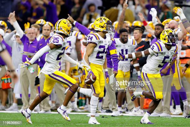 Derek Stingley Jr #24 of the LSU Tigers reacts to a fumble against Clemson Tigers in the College Football Playoff National Championship game at...