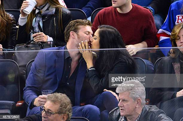 Derek Theler and Christina Ochoa attend the Minnesota Wild vs New York Rangers game at Madison Square Garden on October 27 2014 in New York City