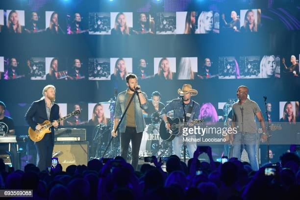 Derek Trucks Charles Kelley of Lady Antebellum Jason Aldean and Darius Rucker perform onstage during the 2017 CMT Music Awards at the Music City...