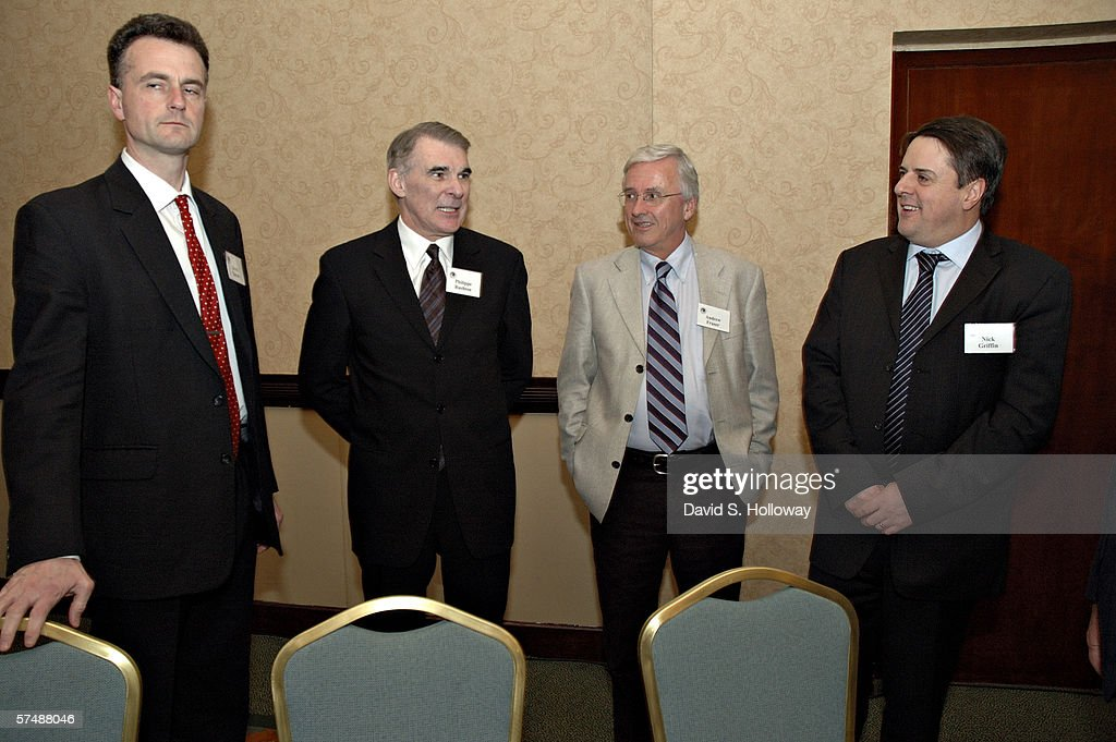 Derek Turner, left, Phil Rushton, Andrew Fraser and Nick Griffin joke around together at the 2006 American Renaissance Conference, themed 'The Global Crisis: Perspectives from Europe, South Africa, Australia and North America' on February 25, 2006 at the Dulles Hyatt in Herndon, Virginia. This is the 7th bi-annual conference held by the magazine American Renaissance and organized by the magazine's editor Jared Taylor.