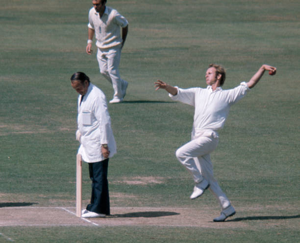 Derek Underwood bowling for England during the 2nd Test match between England and Pakistan at Lord's Cricket Ground London 8th August 1974 The umpire...