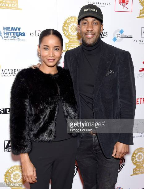 Derek Watkins and Faune Watkins attend the 9th Annual Guild Of Music Supervisors Awards at The Theatre at Ace Hotel on February 13 2019 in Los...