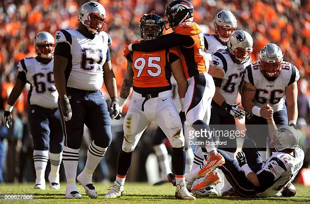 Derek Wolfe of the Denver Broncos celebrates with Von Miller after a sack on Tom Brady of the New England Patriots in the first quarter in the AFC...