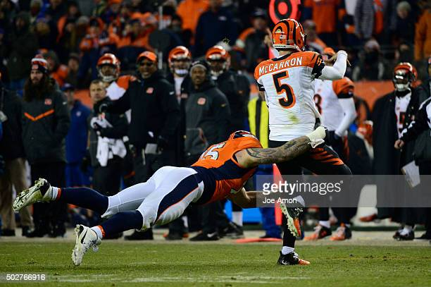 Derek Wolfe of the Denver Broncos chases down AJ McCarron of the Cincinnati Bengals forcing him to throw out of bounds in the fourth quarter The...