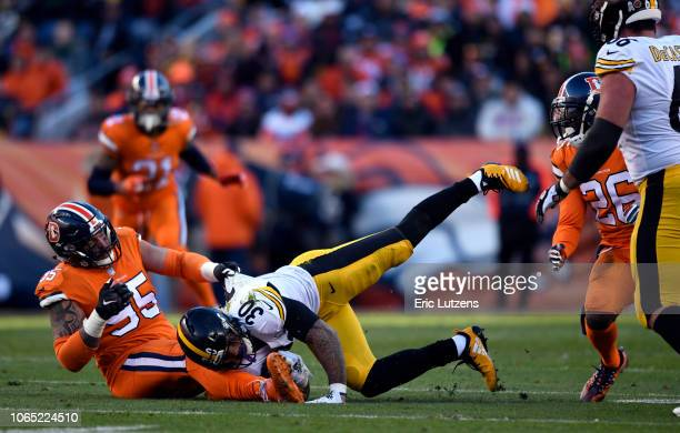 Derek Wolfe of the Denver Broncos takes James Conner of the Pittsburgh Steelers down during the second quarter on Sunday November 25 at Broncos...