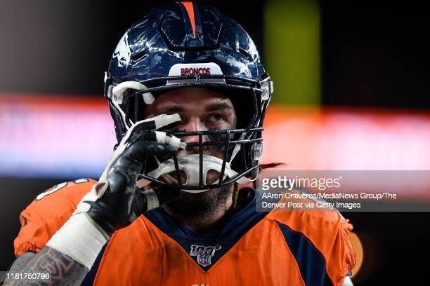 Derek Wolfe of the Denver Broncos walks off of the field after the defense stopped the Kansas City Chiefs during the fourth quarter of Kansas City's...
