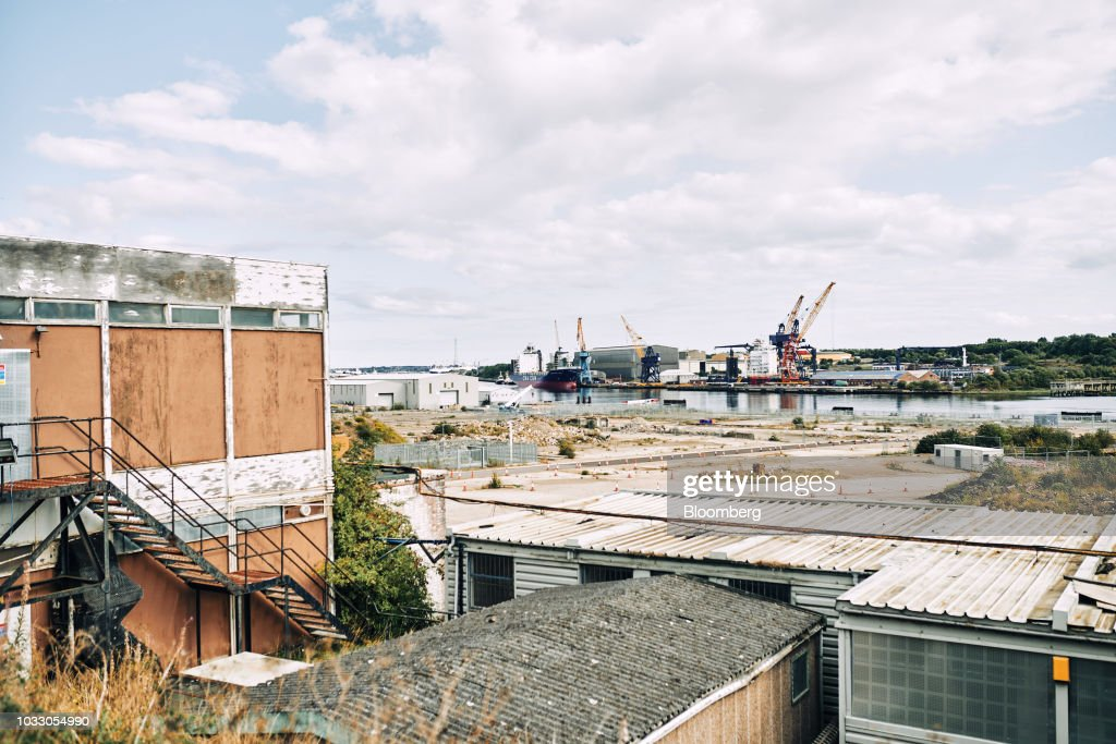 Derelict buildings stand on the site of the former Swan Hunter shipyard in Wallsend, U.K., on Thursday, Sept. 6, 2018. The northeast of England illustrates the precarious position facing many parts of the U.K. just six months before the country is due to leave the EU. Photographer: Matthew Lloyd/Bloomberg via Getty Images