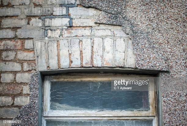derelict crumbling house fascade awaiting demolition - aberfan stock pictures, royalty-free photos & images