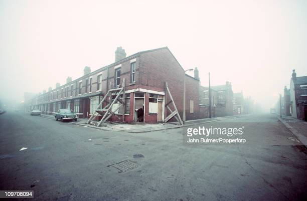 A derelict endofterrace house propped up to prevent its collapse Manchester England 1976