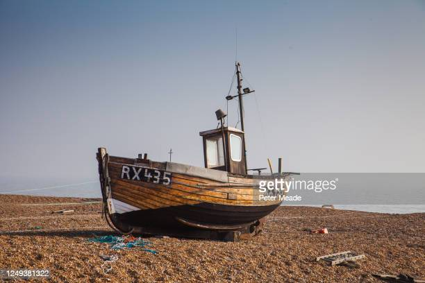 derelict fishing boat on dungeness beach - wreck stock pictures, royalty-free photos & images
