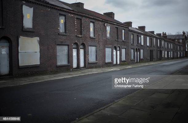 Derelict homes wait for their fate in Toxteth, Liverpool, Local campaigners are calling for the area to be redeveloped and are embroiled in a fight...