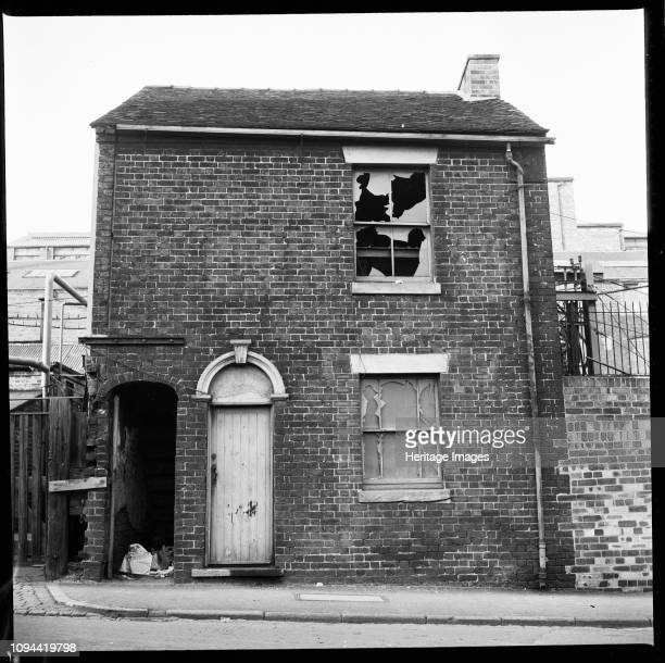 Derelict house StokeonTrent Staffordshire 19651968 A derelict house with an industrial complex in the background This site is unidentified but is...
