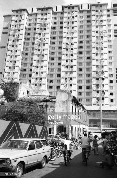 Derelict shophouses on Spring St prior to demolition face the highrise Kreta Ayer Complex Chinatown Singapore 12 July 1983 Today this is the site of...