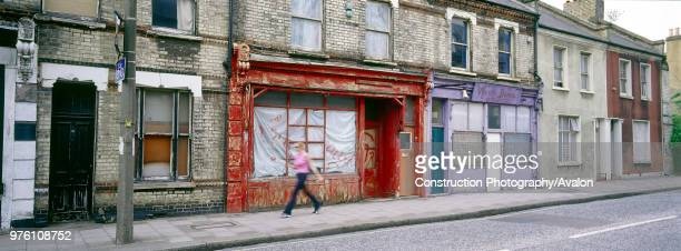 Derelict terraced shop fronts and housing Clapham Common Rectory Grove London United Kingdom