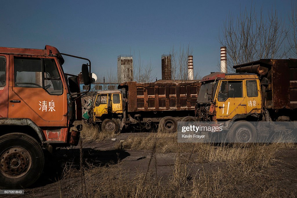 Derelict trucks sit in the abandoned Qingquan Steel plantwhich closed in 2014 and became one of several so-called 'zombie factories', on January 26, 2016 in Tangshan, China. China's government plans to slash steel production by up to 150 million tons, which could see the loss of as many as 400,000 jobs according to state estimates. Officials point to excessive industrial capacity, a slump in demand and plunging prices as they attempt to restructure China's slowing economy. Hebei province, long regarded as China's steel belt, once accounted for nearly a quarter of the country's steel output. In recent years, state-owned steel mills have been shut down and dozens of small privately-owned plants in the area have gone bankrupt.