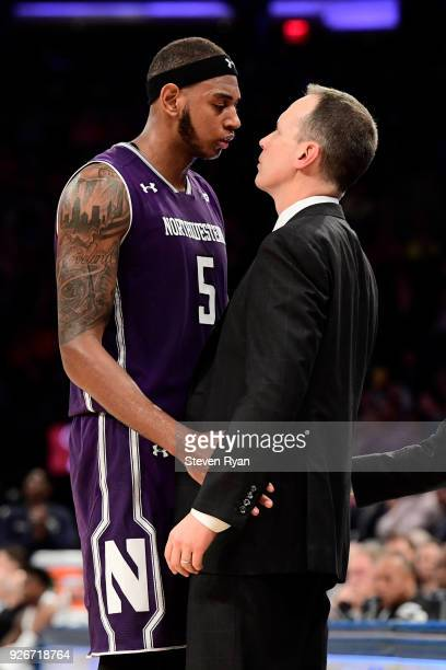 Dererk Pardon and head coach Chris Collins of the Northwestern Wildcats share a moment at the end as he is taken out of the game against the Penn...