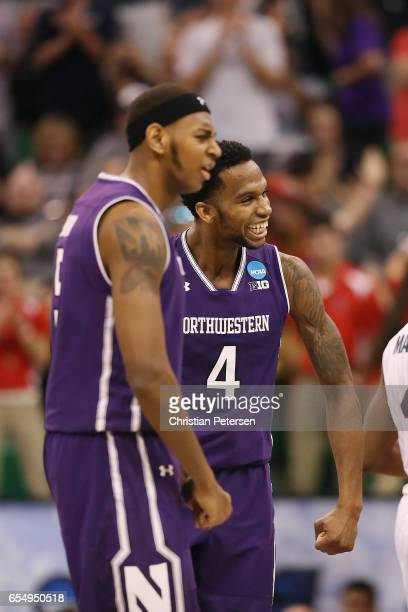 Dererk Pardon and Vic Law of the Northwestern Wildcats celebrate a run of points against the Gonzaga Bulldogs during the second round of the 2017...