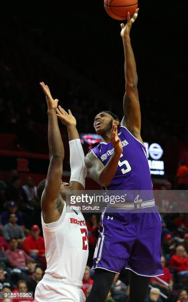 Dererk Pardon of the Northwestern Wildcats attempts a shot as Mamadou Doucoure defends during the second half of a game at Rutgers Athletic Center on...
