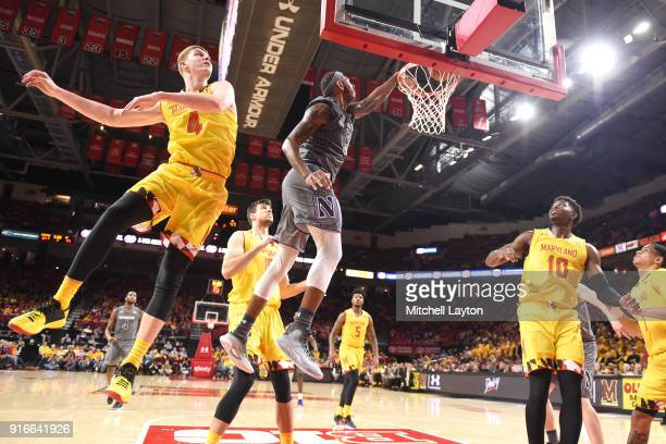 Dererk Pardon of the Northwestern Wildcats drives to the basket over Kevin Huerter of the Maryland Terrapins during a college basketball gam at the...