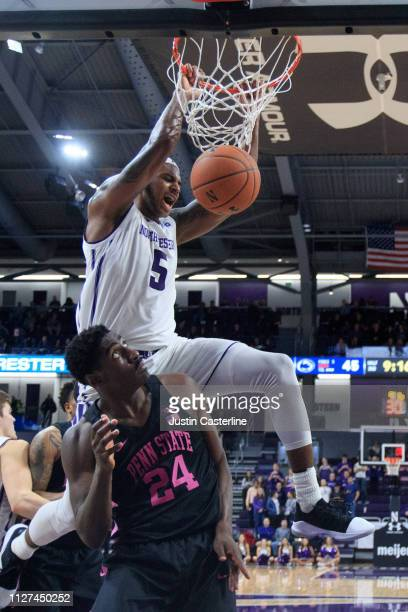 Dererk Pardon of the Northwestern Wildcats dunks the ball over Mike Watkins of the Penn State Nittany Lions during the second half at WelshRyan Arena...