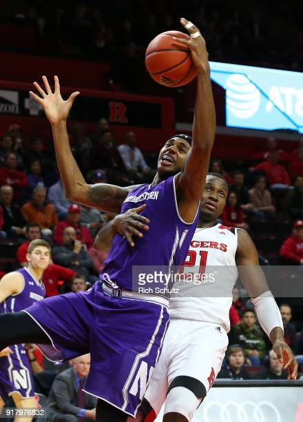 Dererk Pardon of the Northwestern Wildcats is fouled by Mamadou Doucoure of the Rutgers Scarlet Knights as he attempts to grab a rebound during the...
