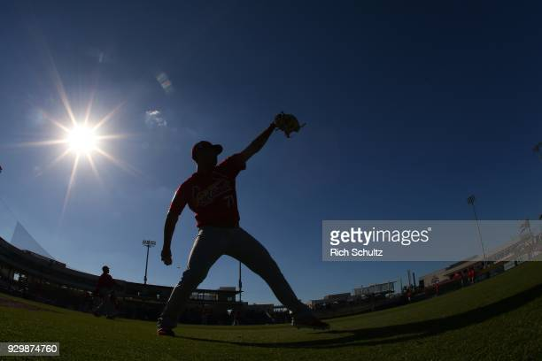 Derian Gonzalez of the St Louis Cardinals is silhouetted as he warms up before a spring training game against the Houston Astros at FITTEAM Ball Park...