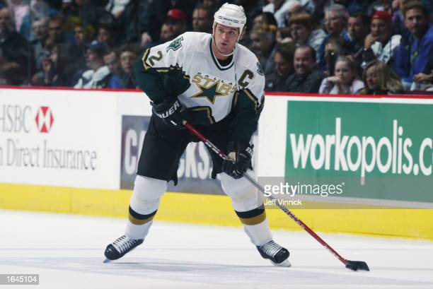 Derian Hatcher#2 of the Dallas Stars has control of the puck during the game against the Vancouver Canucks at General Motors Place on October 26 2002...
