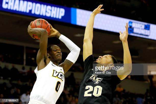 De'Riante Jenkins of the Virginia Commonwealth Rams attempts a shot against Frank Bertz of the UCF Knights in the first half during the first round...