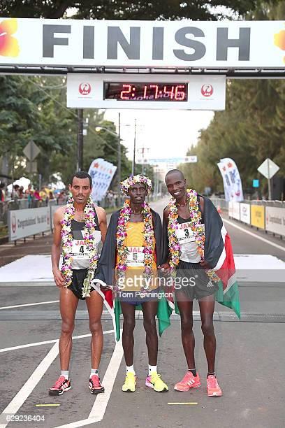 Deribe Robi of Ethiopia, Lawrence Cherono of Kenya, and Wilson Chebet of Kenya pose for a photograph after winning the Honolulu Marathon 2016 on...