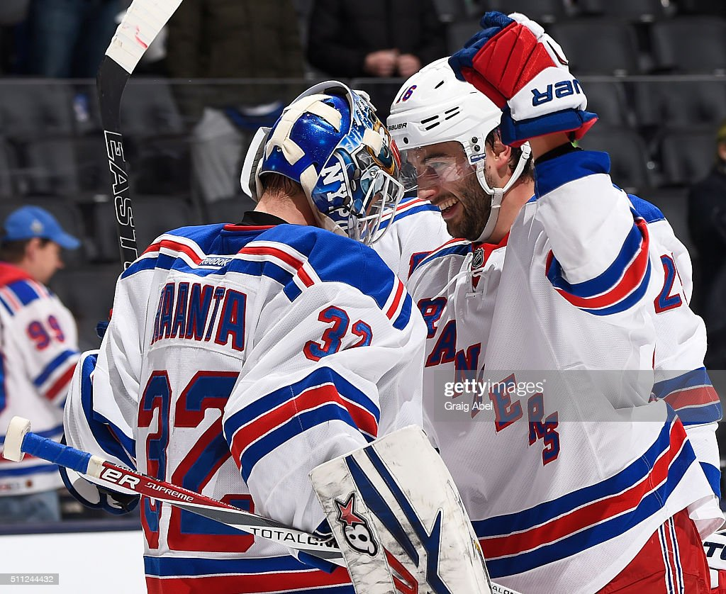 Derick Brassard #16, and Antti Raanta #32 of the New York Rangers celebrate the win against the Toronto Maple Leafs during NHL game action on February 18, 2016 at Air Canada Centre in Toronto, Ontario, Canada.