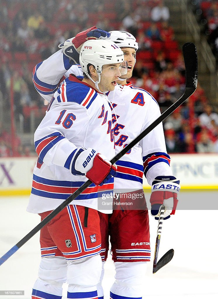 Derick Brassard #16 and Brad Richards #19 of the New York Rangers celebrate after Brassard's first period goal against the Carolina Hurricanes during play at PNC Arena on April 25, 2013 in Raleigh, North Carolina.