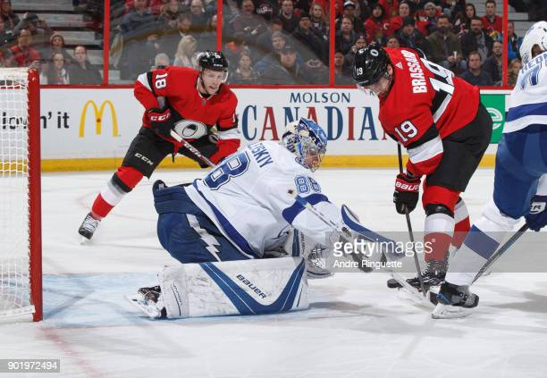 Derick Brassard and Ryan Dzingel of the Ottawa Senators play a rebound after a save by Andrei Vasilevskiy of the Tampa Bay Lightning at Canadian Tire...