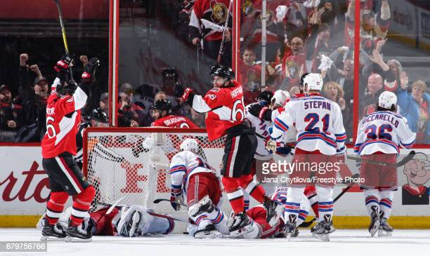 Derick Brassard celebrates his third period game tying goal with teammates Clarke MacArthur and Mike Hoffman of the Ottawa Senators as Henrik...
