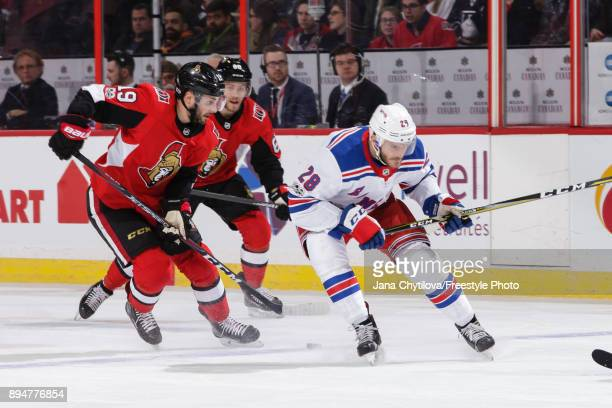 Derick Brassard Mike Hoffman of the Ottawa Senators defend against Paul Carey of the New York Rangers at Canadian Tire Centre on December 4 2017 in...
