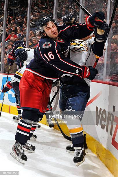 Derick Brassard of the Columbus Blue Jackets checks Jordin Tootoo of the Nashville Predators into the boards during the second period on January 19...