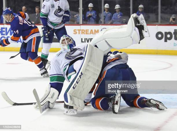 Derick Brassard of the New York Islanders gets caught under Jacob Markstrom of the Vancouver Canucks during the second period at the Barclays Center...