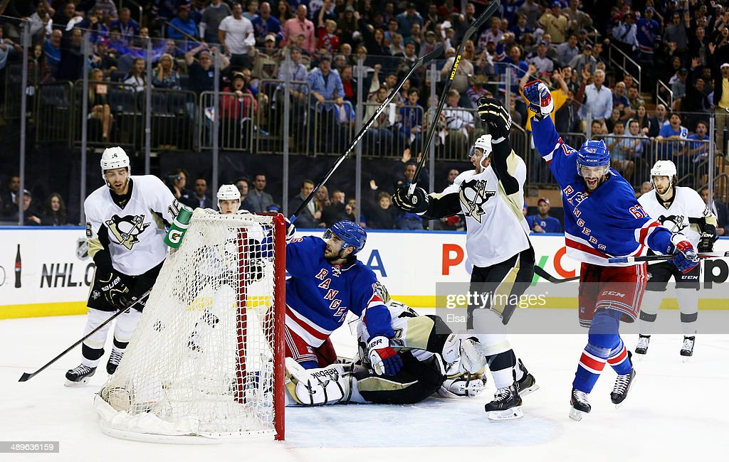 Derick Brassard #16 of the New York Rangers celebrates his goal with teammate Benoit Pouliot #67 in the second period against the Pittsburgh Penguins during Game Six of the Second Round of the 2014 NHL Stanley Cup Playoffs at Madison Square Garden on May 11, 2014 in New York City.