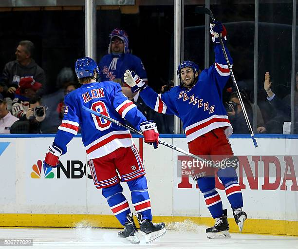 Derick Brassard of the New York Rangers celebrates his goal with teammagte Kevin Klein in the third period against the Buffalo Sabres at Madison...